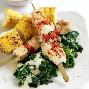 Grilled chicken skewers with hummus yoghurt