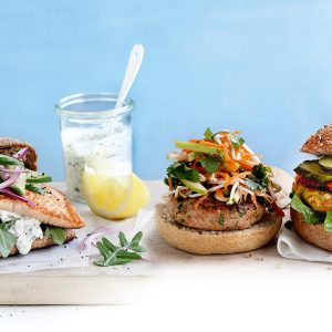 Grilled salmon burgers with dill-caper sauce
