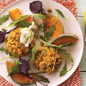 Herby quinoa savoury cakes with spicy dressing