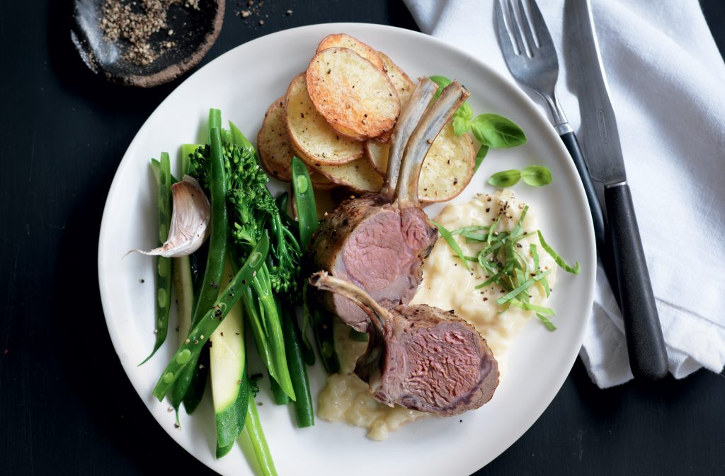 Lamb racks with onion cream sauce and crispy potatoes