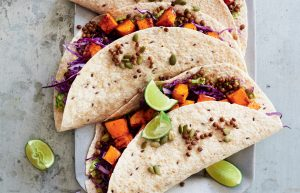 Maple-roasted pumpkin burritos with red slaw