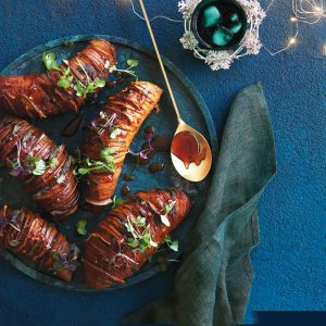Sticky miso hasselback kumara with pear and sage