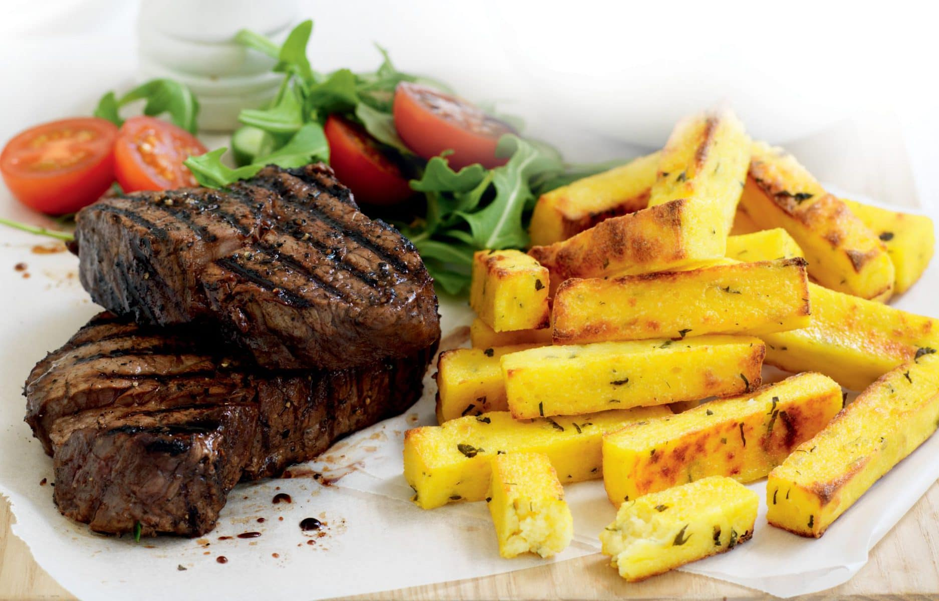 Pepper steak with herb and parmesan polenta chips