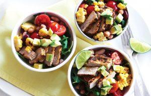 Piri piri pork with grilled corn, avocado and rocket salad