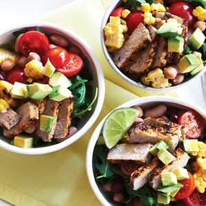 Piri piri pork with grilled corn, avocado and rocket salad