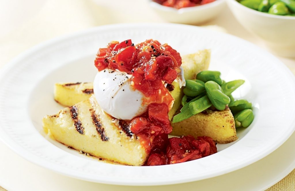 Poached egg on polenta with tomato relish