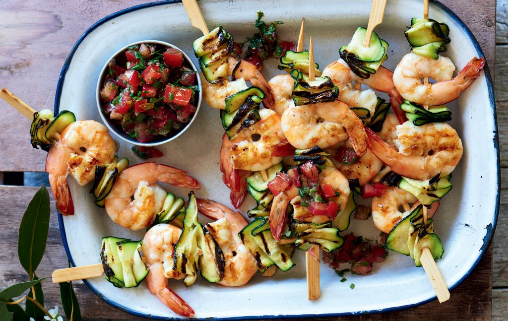 Prawn skewers with lemon, caper and tomato dressing