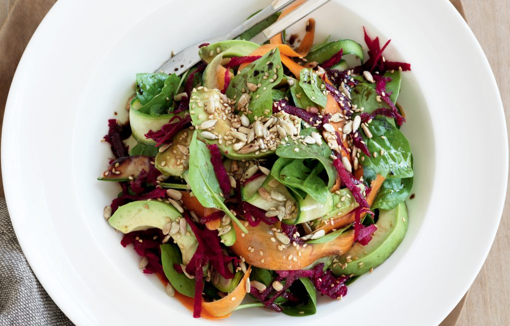Raw vege side salad with avocado and seeds