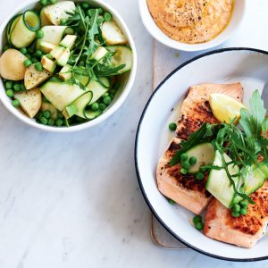Salmon with spring salad and pumpkin hummus