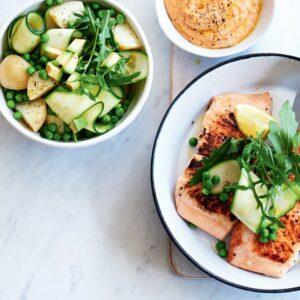 Salmon with spring salad and pumpkin hummus