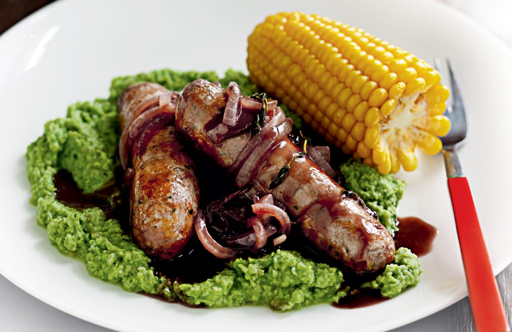 Sausages with pea purée and onion gravy