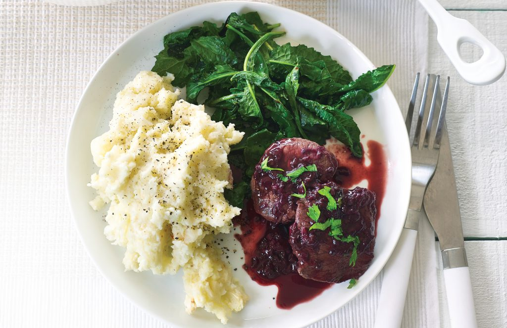 Seared venison with creamy mash and boysenberry sauce