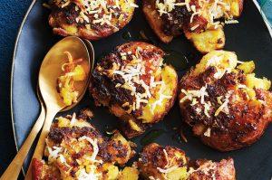 Smashed crispy roast potatoes with turmeric and coconut