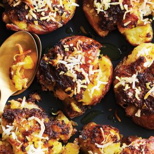 Smashed crispy roast potatoes with turmeric and coconut