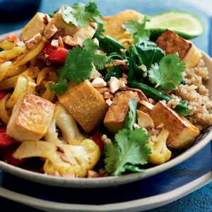 Spiced cauliflower, tofu, Chinese broccoli and cashew stir-fry