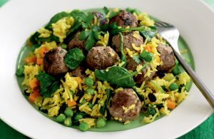 Spiced pilaf with meatballs, currants and baby spinach