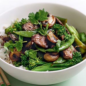 Stir-fried beef with mushrooms, peas and broccolini