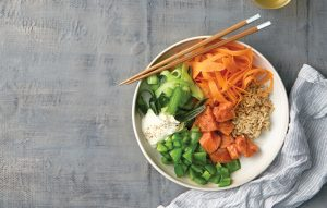Sushi salad bowl with marinated salmon and wasabi mayo