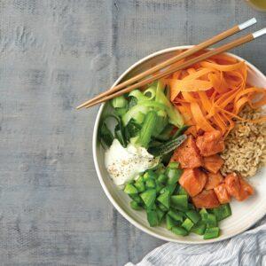 Sushi salad bowl with marinated salmon and wasabi mayo