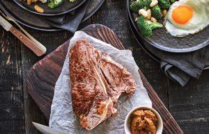 T-bone steak with miso horseradish glaze and white bean salad