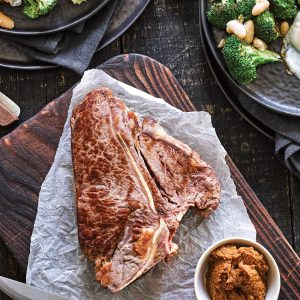 T-bone steak with miso horseradish glaze and white bean salad