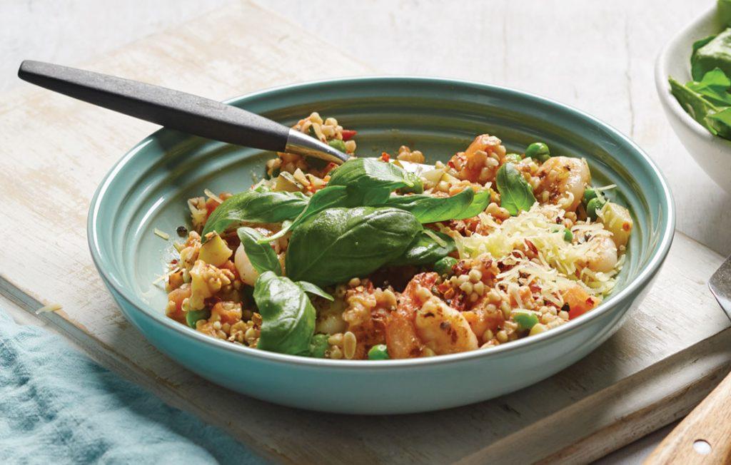 Tomato buckwheat risotto with prawns and rocket salad