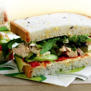 Tuna, hummus, roasted capsicum and cucumber sandwich