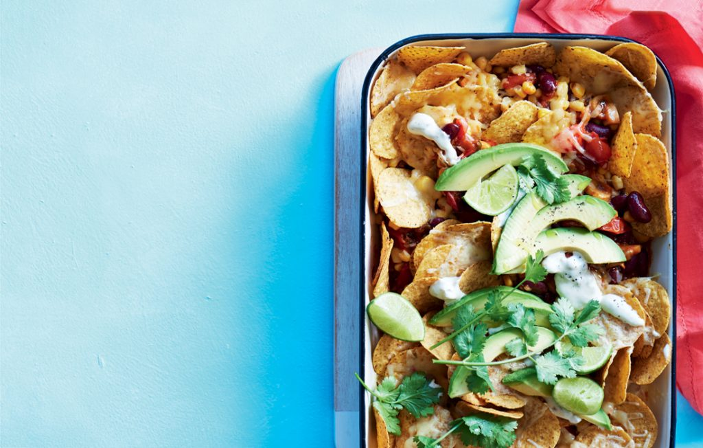 Vegetarian nachos with jalapeño sour cream