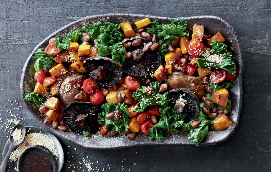 Warm roasted mushroom, kale and pumpkin salad with soy-chilli dressing