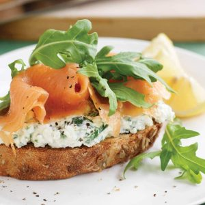 Wholegrain bread with herb cottage cheese, smoked salmon and rocket
