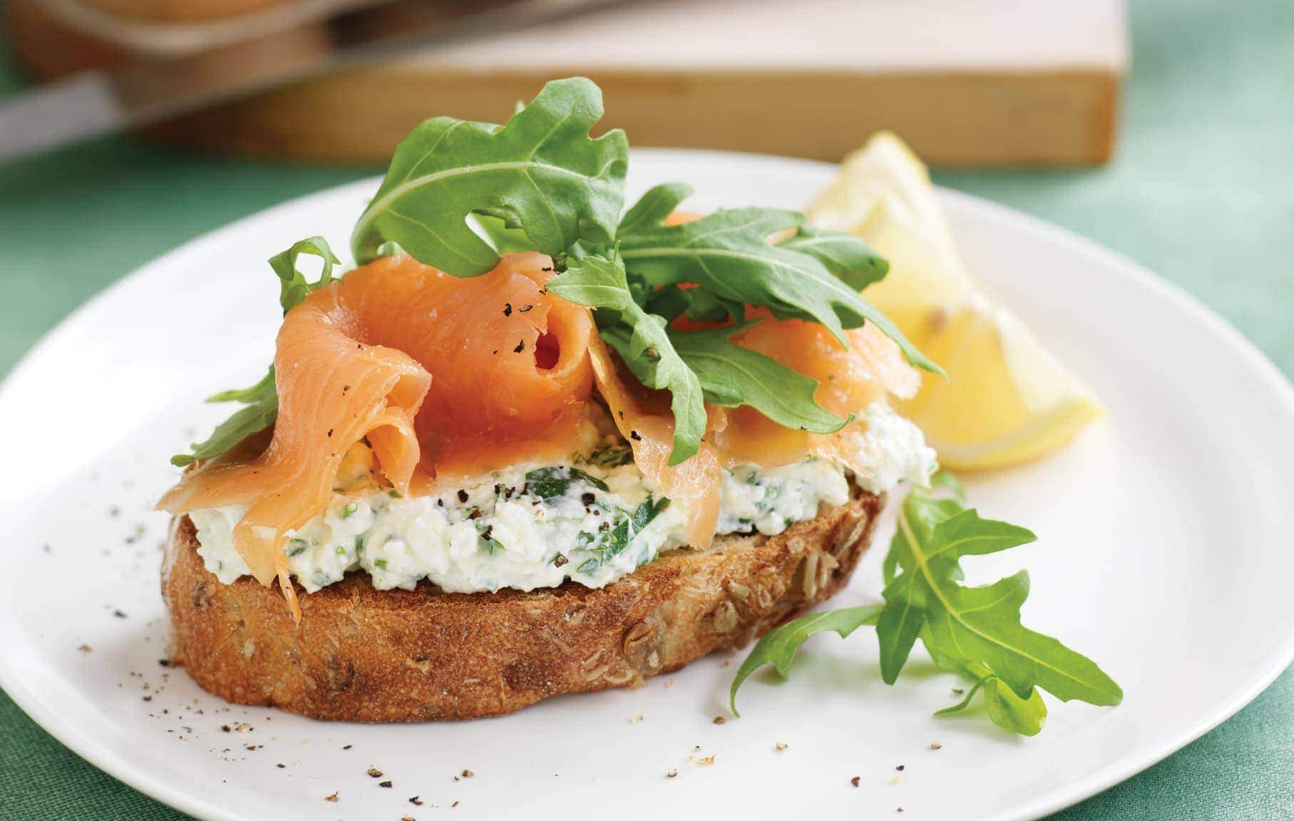 wholegrain bread with herb cottage cheese smoked salmon and rocket healthy food guide. Black Bedroom Furniture Sets. Home Design Ideas