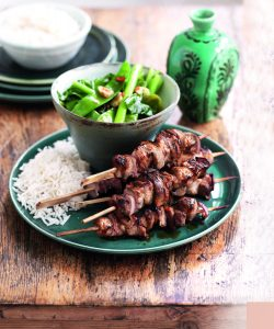 Asian grilled pork skewers with garlic greens