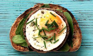 Baked egg and mushroom toast topper