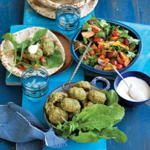 Baked falafels with tahini yoghurt and tomato salad