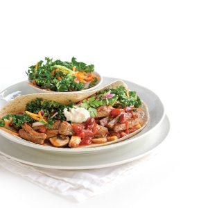 Beef and bean fajitas with carrot and kale slaw
