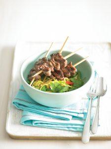Beef kebabs with vegetable noodle salad