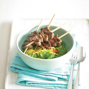 Beef kebabs with vegetable noodle salad