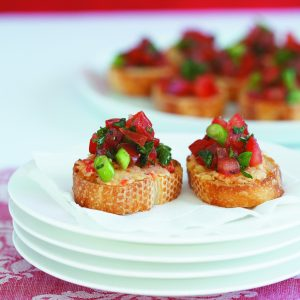 Bruschetta with chickpea spread and basil tomatoes