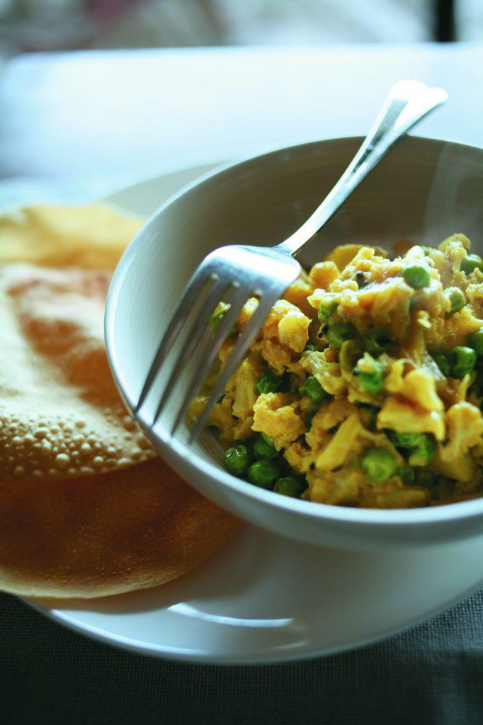 Cauliflower, pea and potato curry with poppadums