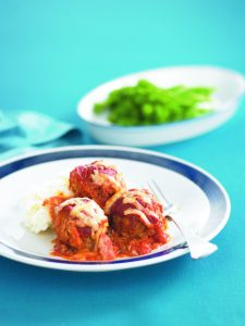 Cheese and tomato-topped lamb meatballs