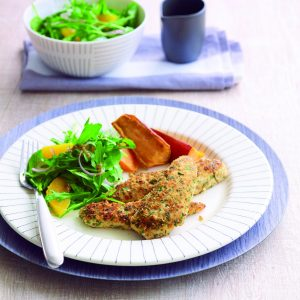 Crumbed chicken with rocket salad and wedges