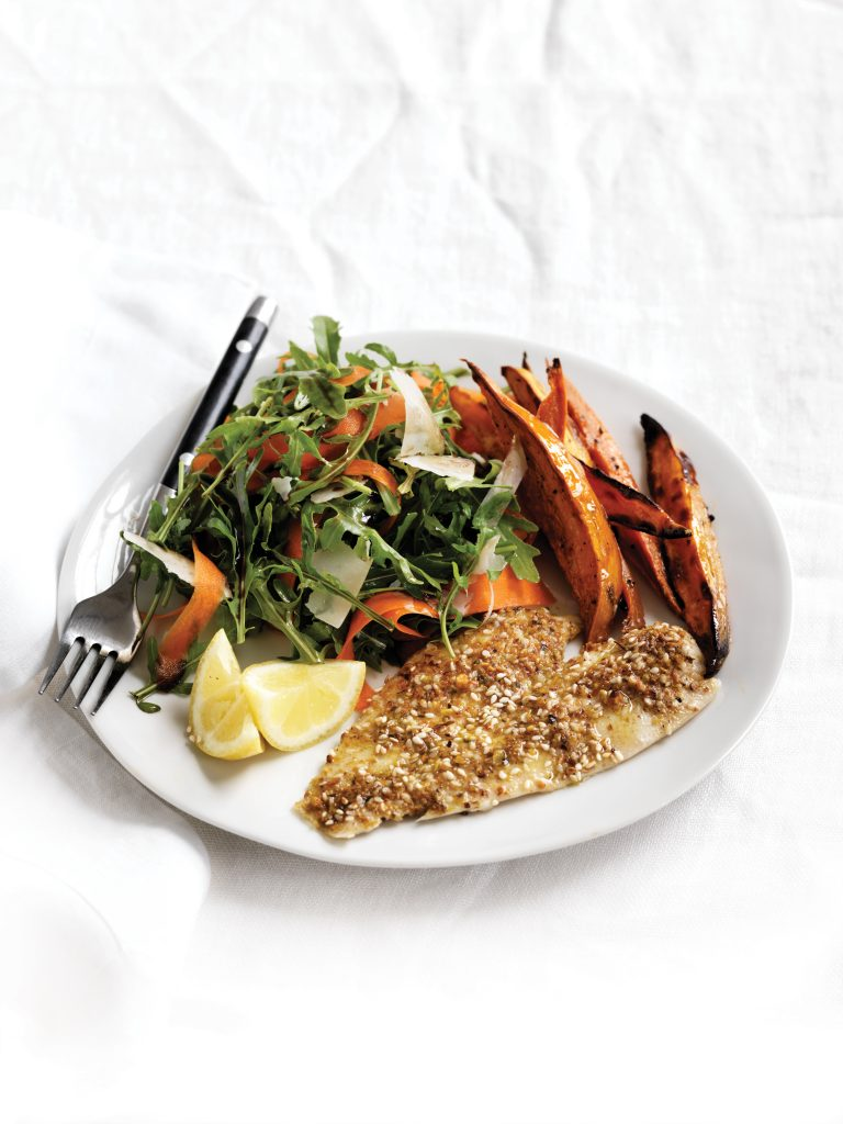 Dukkah-crumbed fish with rocket and parmesan salad and oven-baked chips