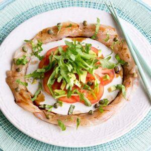 Fish carpaccio with avocado and tomato