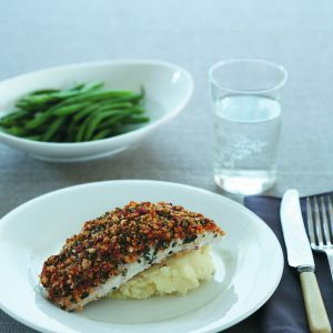 Fish with cashew and basil topping