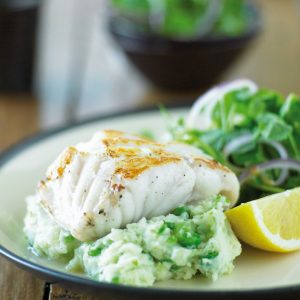 Fish with cheesy pea mash