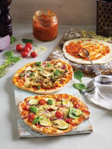 Chicken and asparagus individual pizzas