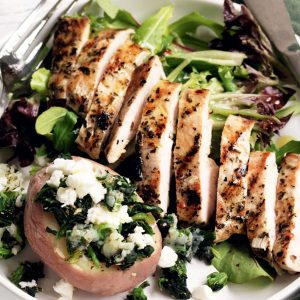 Garlic chicken with spinach and feta-stuffed potatoes