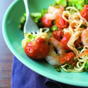 Garlic prawns with broccoli and squashed tomatoes