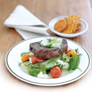 Grilled fillet steak with charred tomato and feta salad