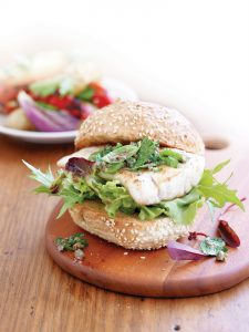 Grilled fish burgers with basil and caper salsa